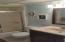 Both bathrooms have been upgraded with new light fixtures, cabinetry, mirrors, and sinks.