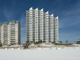 Spectacular Views! Great Investment!  Unique Opportunity!   Very few 3 bedroom 3 bath Gulf Front Condo come on the market in Miramar Beach in an Unrestricted Rental Building.  It is even rarer for a coveted 3 BEDROOM 3 BATH WESTERN CORNER UNIT in Hidden Dunes Gulfside to come on the market!  The views are amazing from every angle. Updated and fully furnished by Sugar Beach interiors.  Similar units generate 50-60k in gross rental income, Hidden Dunes Resort is flanked on both sides by single family home neighborhoods allowing for incredible views from your living room, kitchen and master bedroom. You will see the sun rise, the dolphins playing, the sun setting and the seasonal fireworks show all from your large private balcony. The view from the guest suites allow you to see across Miramar Beach to the Bay.  The kitchen is completely updated with refaced cabinets, beautiful counter tops, new stainless appliances including a wine cooler. The kitchen has is a full-sized washer and dryer closet and separate pantry Additional features include tile throughout living areas and baths with carpet in the master and guest bedrooms. Custom Plantation shutter throughout the entire unit so no window treatments necessary. This condo would make a great high end rental property or a luxury vacation home. This unit is currently on a rental program and is being offered fully furnished and rental ready.    Hidden Dunes is a low density, gated, beach front resort consisting of 27 manicured acres with an abundance of mature natural vegetation, walking paths, lighted fountains and pools. This beach front development offers a professional tennis facility with 6 rubico courts and a Proshop, in season tram service, lighted Basketball Court and Pickleball court, horseshoe Pits, 4 Pools, 3 hot tubs, BBQ Grills, workout facility, and 24 hour security. Hidden Dunes offers a private beach with seasonal beach service. The Gulfside I condo has its own pool, baby pool, & hot tub all on the beach si