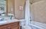 Additional Bath - Tumbled marble floors, Intricate mosaic marble showers, Hand rubbed antique custom finished cabinetry, All plumbing by Fleur de Lis, [fabulous European Reproduction]