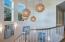 Floating mahogany staircase, designer lighting