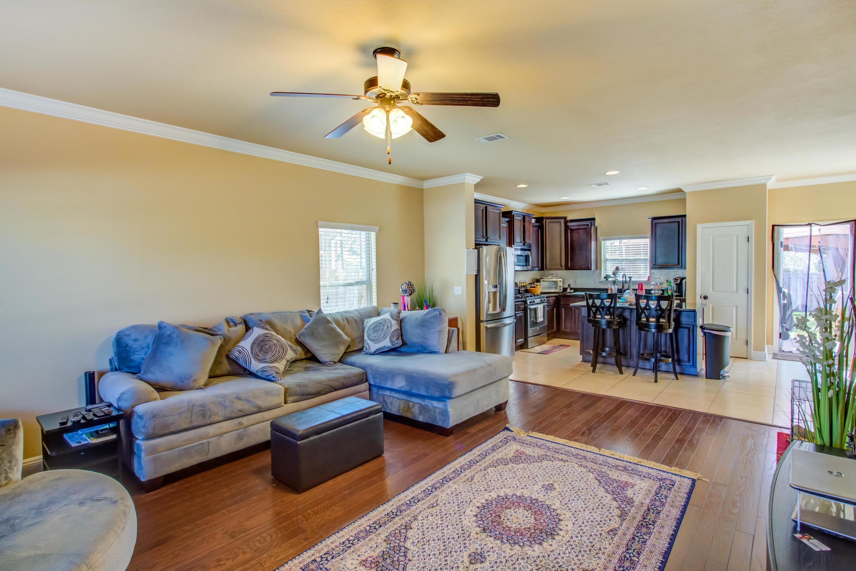 Enjoy an amazing lifestyle in your beautiful home on the Preserve in Hammock Bay!  This one owner home, built in 2014, features an open concept floor plan & bonus room. The large back yard backs to lush green preserve and has been totally enclosed with a 6 foot privacy fence.  You will love the wood floors in the family room with ample space for entertaining your family and friends. The chef in the family will appreciate the kitchen w/ granite countertops, island and stainless appliances!  The large master bedroom is downstairs and looks out onto the yard and trees.  In the master bath are double vanities and a spacious tiled shower.  The master closet is generously sized and easy to keep organized.  Upstairs are two bedrooms connected with a jack and jill bath with double sinks.  The bon also upstairs, is very large and lends itself to so many possibilities.  With ample curb appeal and located in coveted Passages, this house may be your perfect home!  Hammock Bay is a 3,000 acre neighborhood with entrances to the North, East and West.  The beautiful grounds and amenities are maintained by an HOA.  The monthly HOA fee includes access to all pools, fitness center, theatre, owners' club and lanai, tennis, basketball, pickle ball, playground, doggie park, BBQ pavilion, and outdoor theatre for concerts and performances.  The adjacent 60 acre Regional Sports Complex provides the perfect venue for the annual antique car show, seafood festival, and rodeo as well as little league games and soccer practices.  Accessible with your amenities key fob is the HB Bay Club and Fishing Pier just minutes from the west entrance.  For the boaters, two boat ramps are within five minutes of the east entrance giving you access to the beautiful Choctawhatchee Bay and the Gulf of Mexico!  Private RV and boat storage area is available on-site in Hammock Bay for an extra fee.  There is no other neighborhood like Hammock Bay in the tri-county area!  Buyer to verify all square footage and infor