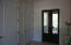 Foyer - French doors lead out to Ground floor porch. Elevator is the 1st White door
