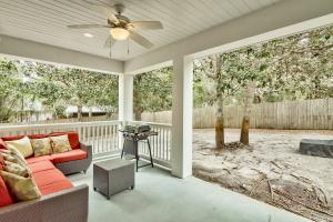 The covered patio provides a relaxing place to grill or just unwind after a day at the beach. Two sets of double doors offer access from the living area and the dining area.
