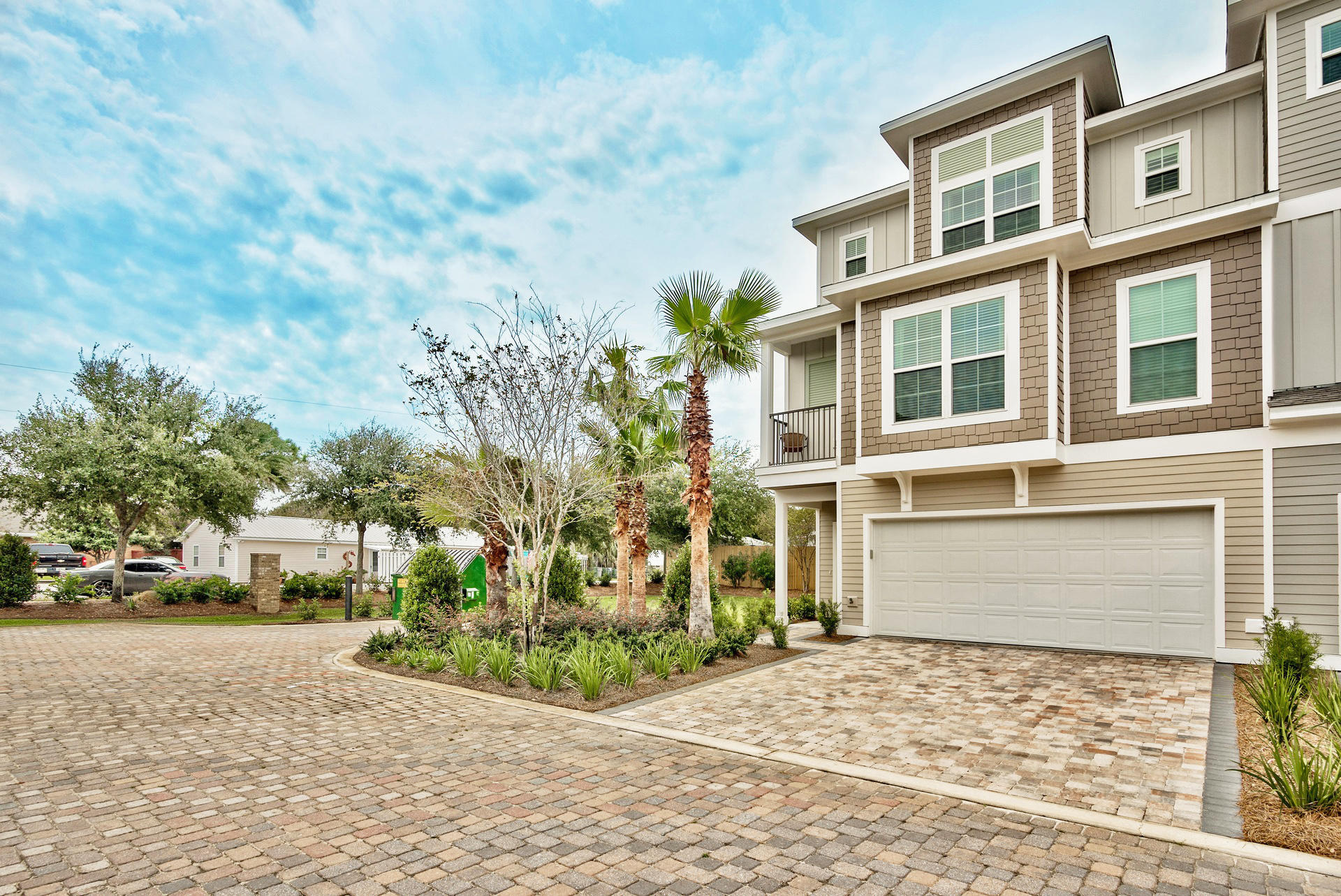 This stunning 5 bedroom home, just 700' from access to the beach and gulf front restaurants, is an investors dream! The curb appeal of this development is a beautiful introduction to what you'll find when you step inside. This dream beach home boasts 3-stories of oak hardwood and porcelain tile floors, stainless steel Frigidaire appliances, crown molding, impact resistant doors and windows, 9' ceilings, and 2 sets of washer/dryers. Other features include: 50 gallon water tank, 3 Carrier heat pump AC units (one per floor), 2-car tiled and insulated garage, and a brick paver driveway. The home is also a Certified Earth Cents home; meaning, it exceeds Florida's current energy efficient building codes.