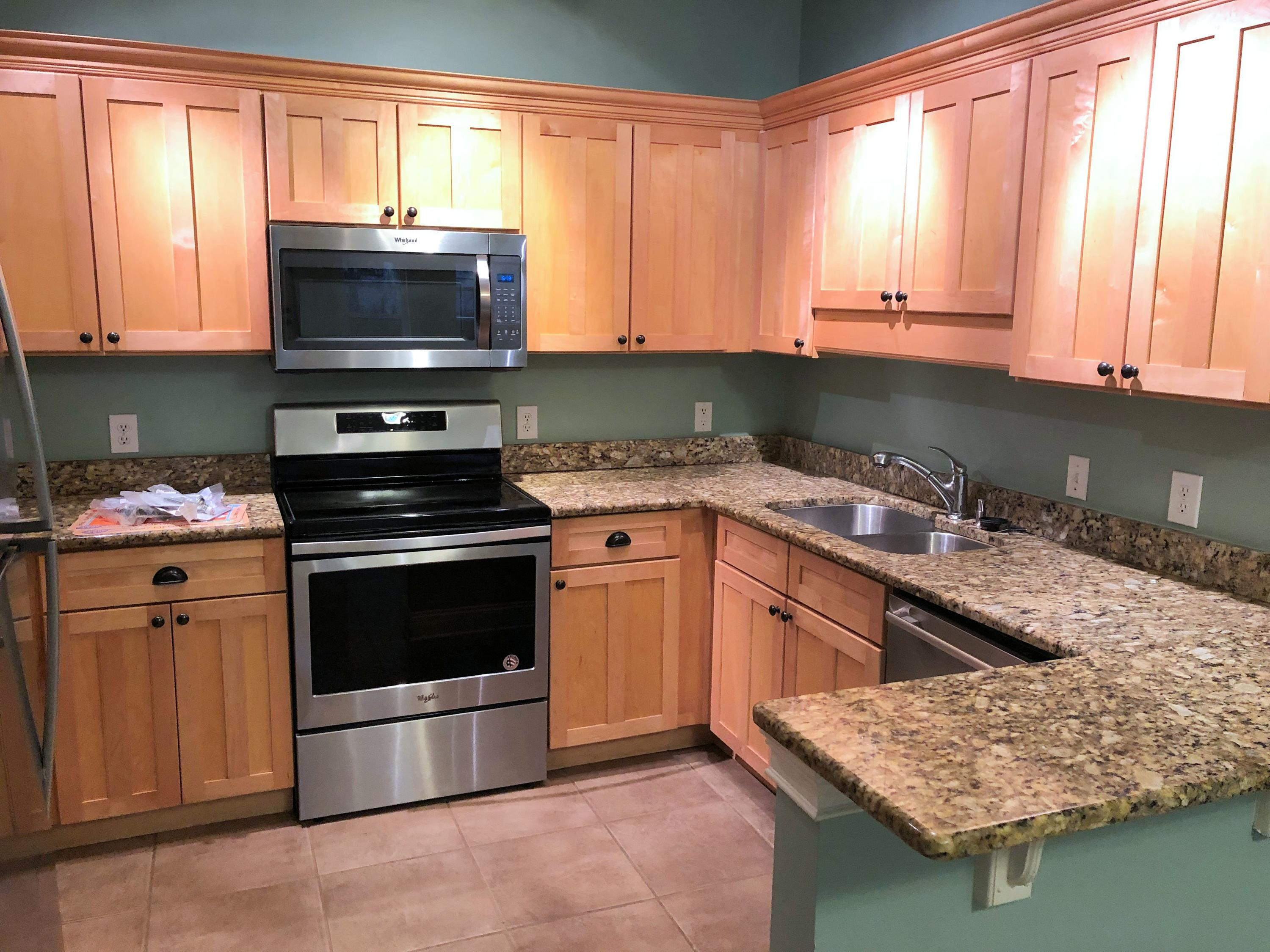 2 Br 2 Ba Condo on the first floor.  New laminate floor just installed.  No carpet.  Unfurnished.  Upgraded new stainless steal appliances in the kitchen, new toilets, and upgraded washer and dryer (2 years old). Beach Access is less than a mile from development.