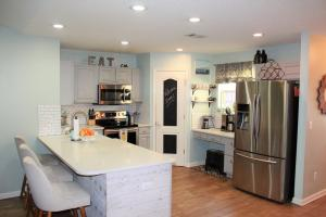 Updated kitchen with quartz counters and stainless steel appliances