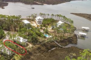 The community pool and dock are seen here, just a feet away from this great lot.
