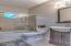 Full bath downstairs, tub/tiled surround