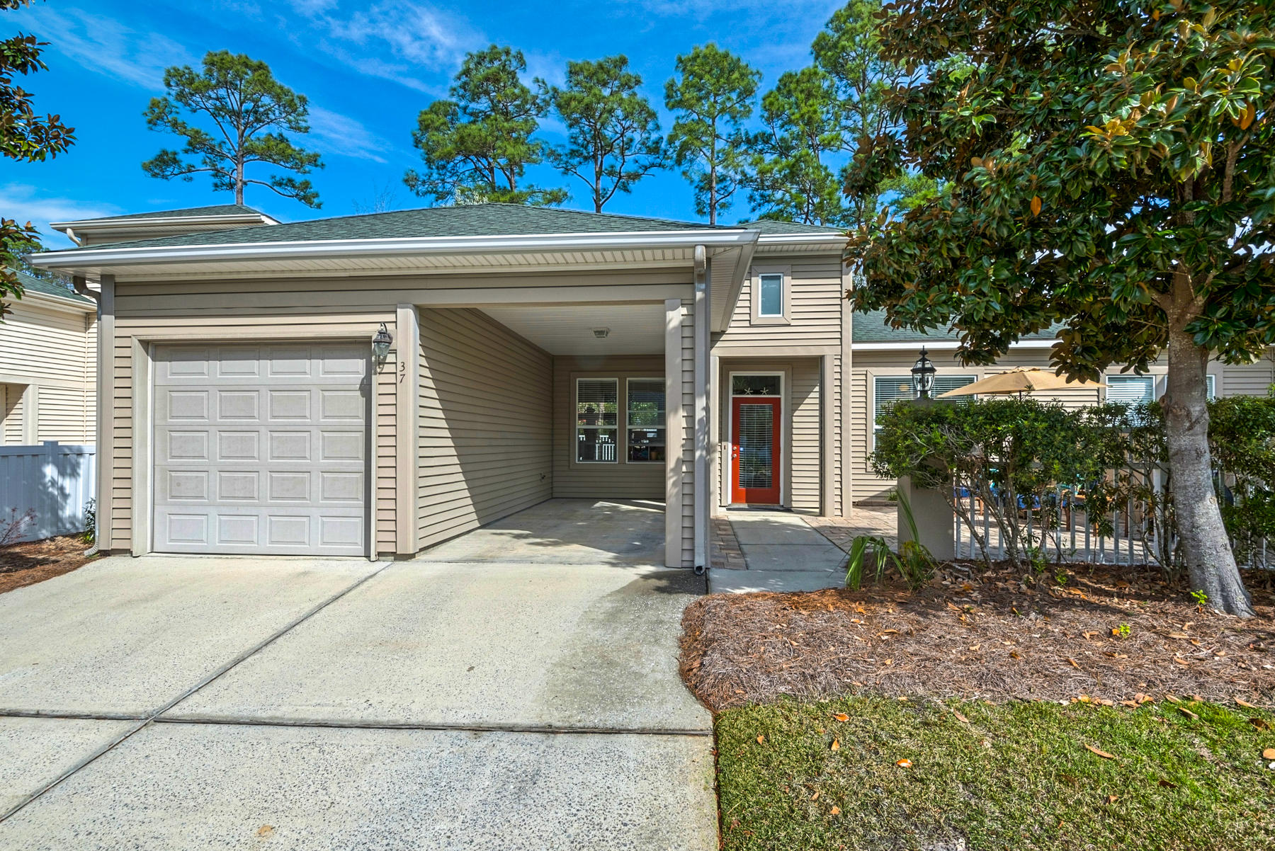 This meticulously cared for town home is located within walking distance to the golf club, a short distance to the beach and 30A bike trails. It is a gated community with a relaxing neighborhood pool. This warm & inviting 2-bedroom, 2 full bath home has an open concept plan with combined living & dining areas. The large living room has a fireplace & french doors that lead to the enclosed courtyard that brings the outside in, perfect for coffee or happy hour. The galley kitchen looks into the dining room and has Corian counter tops, stainless steel appliances and an eat in bar. The master bedroom lets the light in with windows overlooking the courtyard with a large master bath and a walk in closet. The second bedroom is a nice size & overlooks the front courtyard. ADT Pulse Security conveys