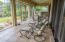 Screened porch is 40' x 12' has tile floors and overlooks Indian Bayou.