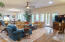 Pecan custom made, wide plank hardwood floors throughout first floor.
