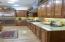 Under cabinet lighting in kitchen with granite backsplash.