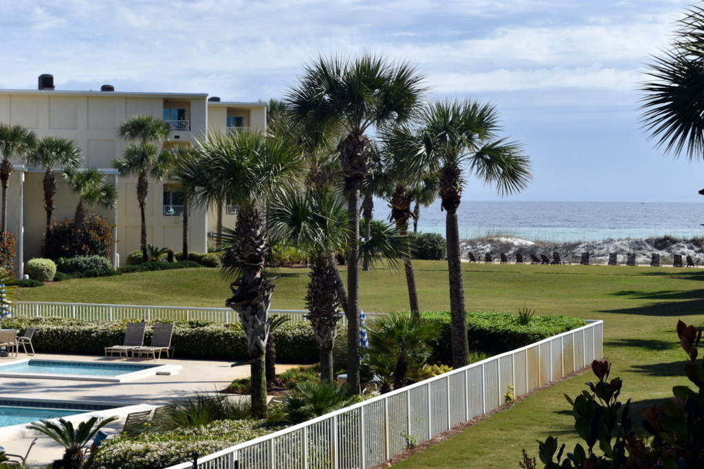PRICE REDUCED $25,000!  GROSS RENTAL INCOME PROJECTION OF $30,000!  This two bedroom, two bath unit has never been rented.  The balcony overlooks the beautiful pool along with views of the gulf.  The condo has 18'' tile throughout.  It has a king bed in the master & two double beds in the spacious second bedroom.  The unit has had some updating.  A big plus is that you can walk down one flight of stairs & you can be in your car in one minute as the parking area is right there or you can walk a few steps more & be at the pool or the beach.  Silver Dunes is an eight acre popular gulf front resort complex close to Big Kahuna's, Target, & many fine & fun restaurants. Other amenities include a gulf front pool, fitness center, arcade room, shuffleboard court, two lighted tennis courts, BBQ grills, & best of all its own deeded beach.