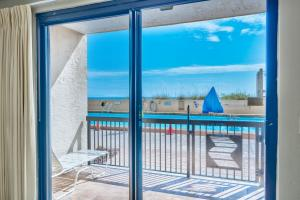 Step directly onto the pool deck from your Gulf front patio.
