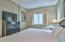 The master bedroom is furnished with a king bed and flat screen tv.