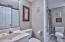 Both bathrooms adjoin each other for access from the bedroom or living area.
