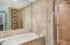 Master bath with sleek marble throughout separate tub and shower