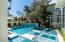 Pool with sun-shelf and waterfall