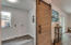 Barn door to the laundry/utility room