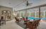 Screened outdoor patio with pool and spa and summer kitchen