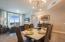 West Elm Lighting above sleek glossy dining table.