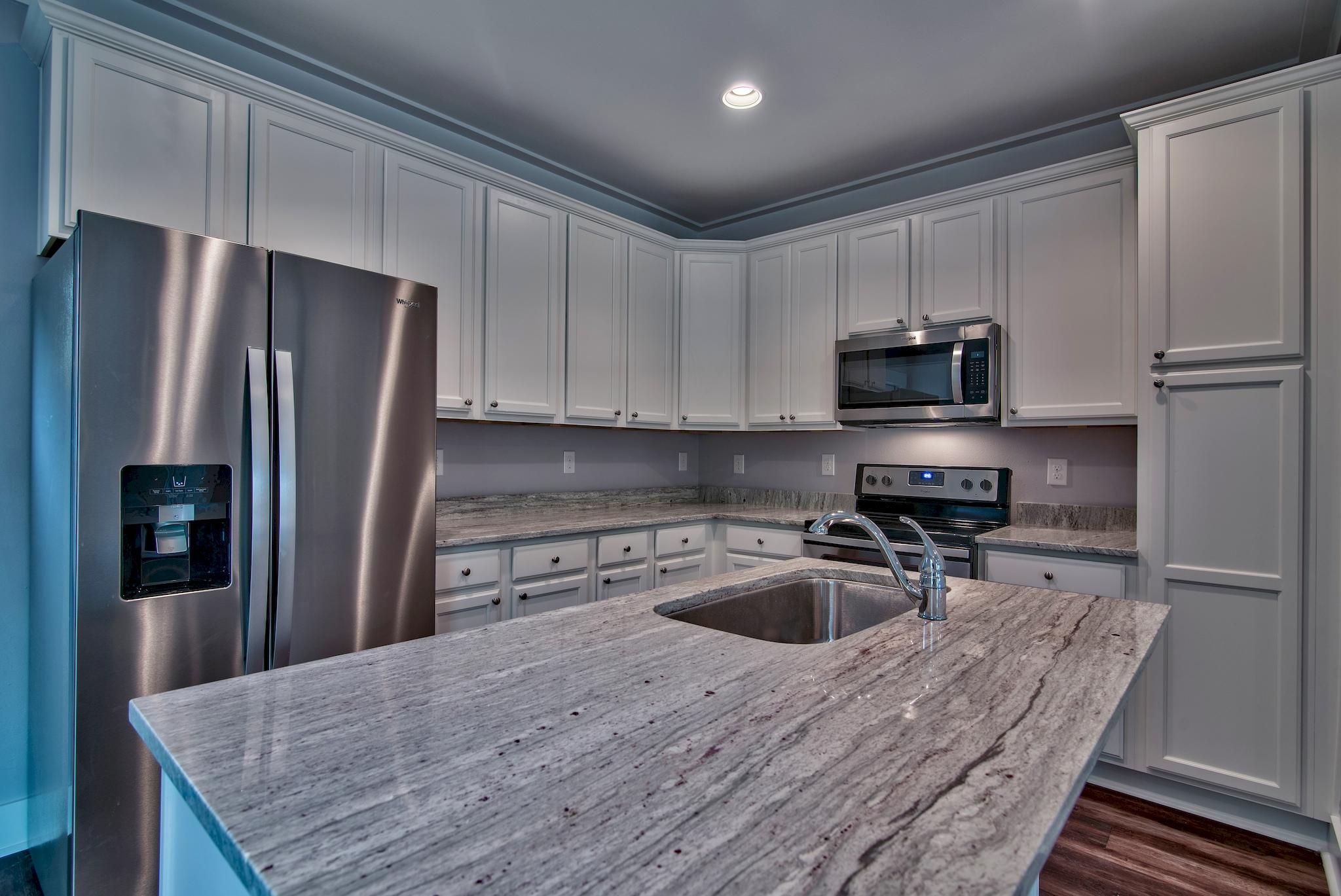 LAST GARAGE UNIT IN THE SOUTH END!! Welcome to The Verandas at Freeport! The Verandas provides you with peaceful serenity for those who want to live close to the beautiful beaches of South Walton without having to deal with the massive crowds and busy streets. Living at The Verandas will put you 15min away from the beach, 20min away from the major shopping and entertainment destinations and 30-40min away from Eglin AFB. The Verandas are currently building out brand new townhomes with three different floor-plans for you to choose from.  These units will include metal roofing, stainless steel appliances, granite countertops, 14 seer ac units, open floor-plans, craftsmen style trim, Sherwin Williams paint, and much more! Call us today for more information!