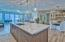 The custom kitchen island features a gorgeous Quartz counter top, updated lighting and custom cabinets. It offers built-in amenities such as USB ports, power outlets, and even the dishwasher has a custom cabinet front.