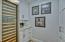 The walk-in pantry includes a dual zone SubZero wine refrigerator, Vetrazzo counters and additional storage space.