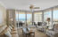 Windows surround the living room