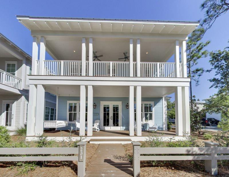 A great opportunity to own a Beach House in Phase 4 ! This corner location offers rear access via Indigo Lane with plenty of parking. Expansive porches offer great space for enjoying the outdoors. This lovely home offers a great design with Carrera Marble in kitchen and baths, V Groove walls, , 4'' wire brushed oak flooring and second floor double bunks. Furnishings and accessories  included with a small exclusions list.