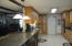 Large Spacious Kitchen, cabinets galore, pantry, breakfast bar, quartz counter tops