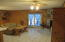 French doors outside from the Den/Bonus Room, with wood fireplace