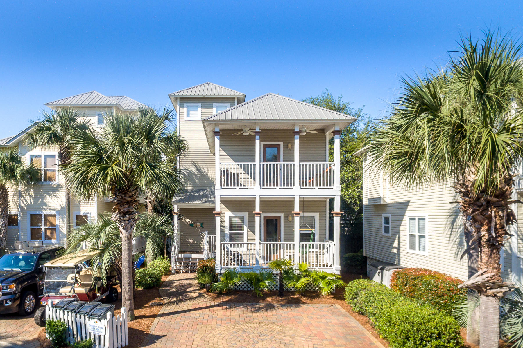 This cozy 3-story townhome, known as ''Medallion House,'' enjoys a fabulous location south of Scenic Highway 30A, directly across from the community pool and just a short walk or bike ride from a fully equipped walkover to the stunning Emerald Coast beach! The first floor features a master suite and 2 additional bedrooms with shared bath. The main gathering area encompasses the second floor; while the 3rd floor is a loft bedroom. Decks expand the living space to the outdoors. The pool facility includes dressing rooms and a dining area, for larger gatherings. An excellent getaway home, rental property, and/or place to retire to the sun, sand and laid-back lifestyle of the Beaches of South Walton!