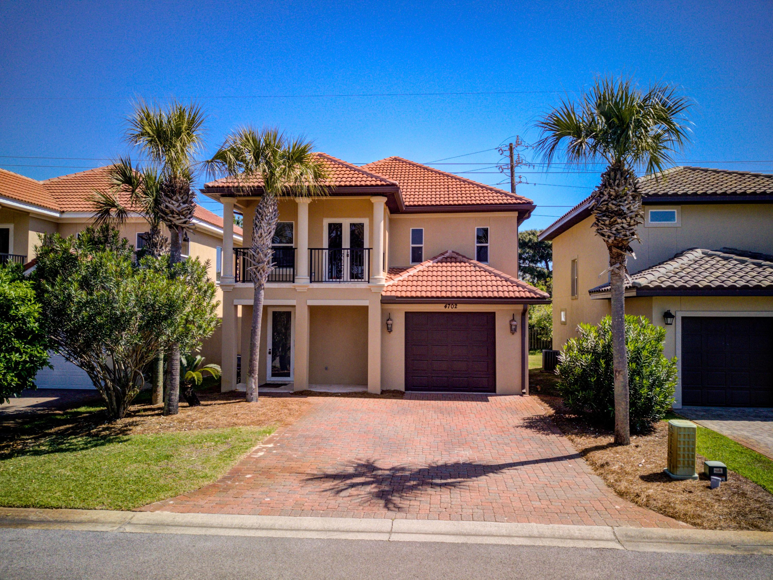 This attractive, Mediterranean-style home is based in a desirable neighborhood in a fabulous Destin location! Calusa Bay subdivision is north of Highway 98 across from Destiny East and not far from Regatta Bay, within easy access of many of Destin's best shopping, dining and resources--and of course the beautiful beach and sparkling waters of the Gulf of Mexico! This residence backs up to green space, including a jogging trail, and overlooks a lake. It features an open living/dining room/kitchen with travertine floors, black granite kitchen counters and a breakfast bar. All 3 bedrooms are upstairs, including the large master bedroom with dual sinks, a jetted tub and a large balcony. The home includes a one-car garage with storage space.     Calusa Bay offers its owners a lovely poo gated entry and a fantastic home base from which to enjoy the very best of the Emerald Coast!