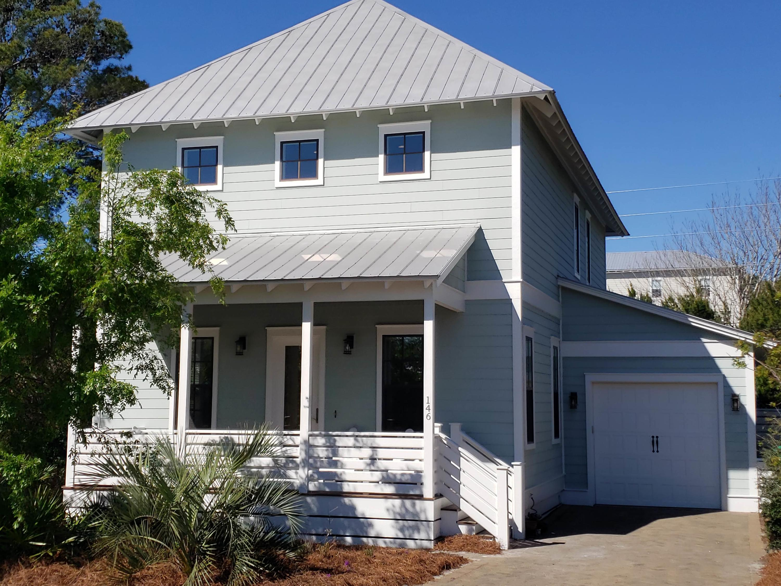 Located only two blocks to the beach, this neighborhood on Big Redfish Lake, is nestled between the State Forest with hiking and biking trails, and Redfish Village which offers shops, dining and much more. Easy to get to so many places in Blue Mountain Beach from this beach cottage. Inside, the 21 foot architectural beam ceiling invite you in to the open floor plan with living and dining in front, and spacious kitchen just beyond. SS Kitchen Aid appliance including ice machine. The master suite, laundry room and half bath are also on first floor. Varying-width solid oak flooring is throughout this home, with travertine flooring in bathrooms. 10 ft ceilings with crown molding and 8ft solid-core doors throughout the home. The details of this home truly stand out from the others in the area.