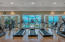 Treadmills in the State of the Art Fitness Center overlook the outdoor Infinity Pools and waterviews.