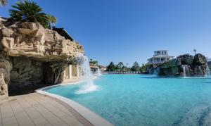 One of seven waterfalls at the 13,000 sq. ft. Cypress Breeze Plantation private community pool