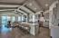 The main living area and kitchen is positioned on the top floor to maximize the Gulf views and features beautiful stained oak flooring and cathedral beamed ceiling.
