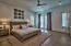 Phenomenal master bedroom with beautiful stained oak flooring and direct access to a private balcony.