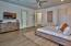 Master suite has a walk-in closet , large flat screen TV and inviting furniture & decor