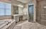 Breathtaking master bathroom with a separate vanity area, custom walk-in shower and Jacuzzi tub.