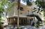 Florida cottage nestled on over 1/2 acre Bayou front site