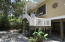 Spanish Cedar Bahama Shutters and main entry front door