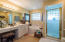 Master bath features Jacuzzi tub, walk-in shower