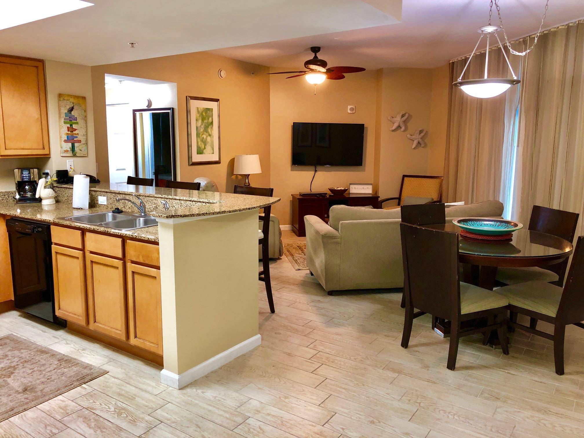 Full 2 bedroom inside corner unit. Seller just completed a light renovation and replaced all carpet with wood-look tile. All fans and TV's were recently replaced as well. Great views of 11,000 sq ft resort style pool. Other amenities include beach shuttle, tennis courts, basketball court, fitness center, and covered parking. Rental income has varied from $28,000-$32,000 depending on owner use.