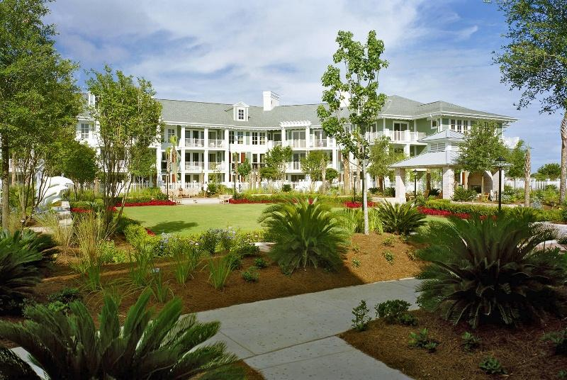 """Versatile 5th floor, 1 bedroom condominium with a converted den, sleeper sofa, and king bed, located within Pilot House in The Village of Baytowne Wharf.  Updated to include all hard surface floors (no carpeting!) and new furnishings where needed. The balcony, overlooking the lush greenery of the terrace, is surrounded by trees for privacy.  Pilot house offers strong rental income as well as a place to make memories with your family & friends.  With entertainment options for all ages, you will enjoy the amenity terrace with large pool, hot & cold spas, kiddie pool, fitness center, outdoor grilling and seating area, and green space with fireplace. Additional amenities include garage parking, separate storage, owner's closet, and The Founder's Club, a gathering spot for large or small groups with bar area, game area with pool table, sitting area with large screened TV, and a spacious balcony overlooking The Village excitement.  Enjoy live music and events, fireworks, and dancing just outside your resort home!    As an introduction to the Sandestin lifestyle, we invite our new owners to explore amenities that make Sandestin special. The listing brokerage and seller(s) are presenting the buyer(s) of this property with (2) 90-minute rounds of Tennis court time, a golf foursome at one of our three championship courses, a round of golf for up to four (4) players and an invitation to """"Club Night"""" at the unrivaled Burnt Pine Golf Club.   Sandestin Golf and Beach Resort is a major destination for all seasons and all ages, and has been named the #1 resort on Florida's Emerald Coast. This magical resort spanning over 2,000 acres is comprised of over 70 unique neighborhoods of condominiums, villas, town homes, and estates.  The resort features miles of sandy white beaches and pristine bay front, four championship golf courses, a world-class tennis center with 15 courts, 4 resort swimming pools (and 15 private neighborhood pools), a 113-slip marina, a fully equipped and professio"""