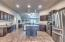 Kitchen features island and stainless steel appliances