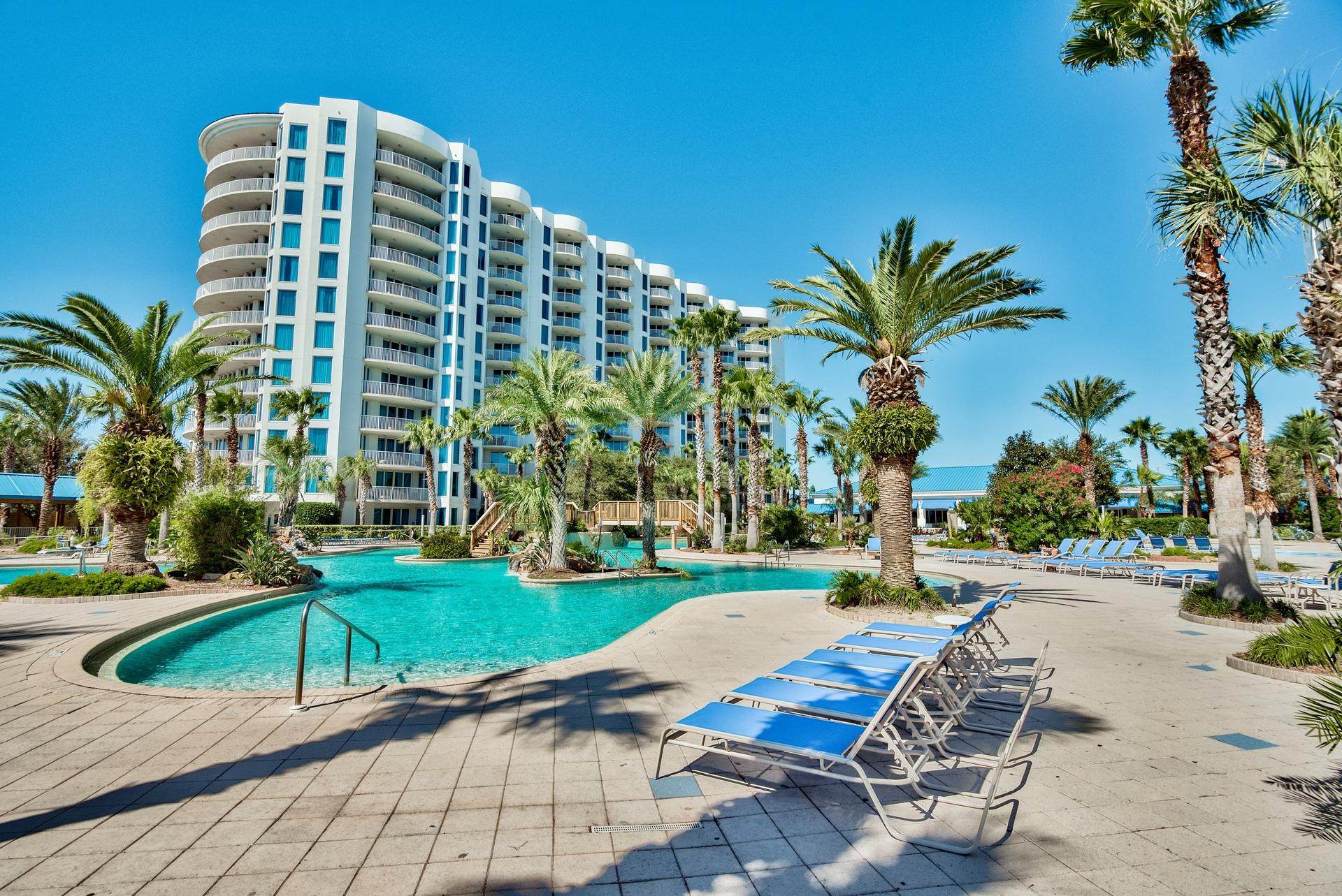 9th floor unit at The Palms of Destin! The Westerly views of Destin and of course the sunsets and the Gulf are incredible. Kitchen features granite countertops and maple cabinetry. Amenities at The Palms are first class. They include an expansive 11,000 SF lagoon pool with waterfall and spa, children's pool, playground and splash pool, lighted tennis and basketball courts, first class fitness center, seasonal shuttle service to the beach, and covered protected parking. Also on site is the  conference center, office center, and reception desk. THE ASSOCIATION FEES INCLUDE ALL UTILITIES, INCLUDING ELECTRICITY, WATER, CABLE, INTERNET, AND LOCAL PHONE SERVICE. Buyer to please verify all information including square footage, room dimensions, and all else.