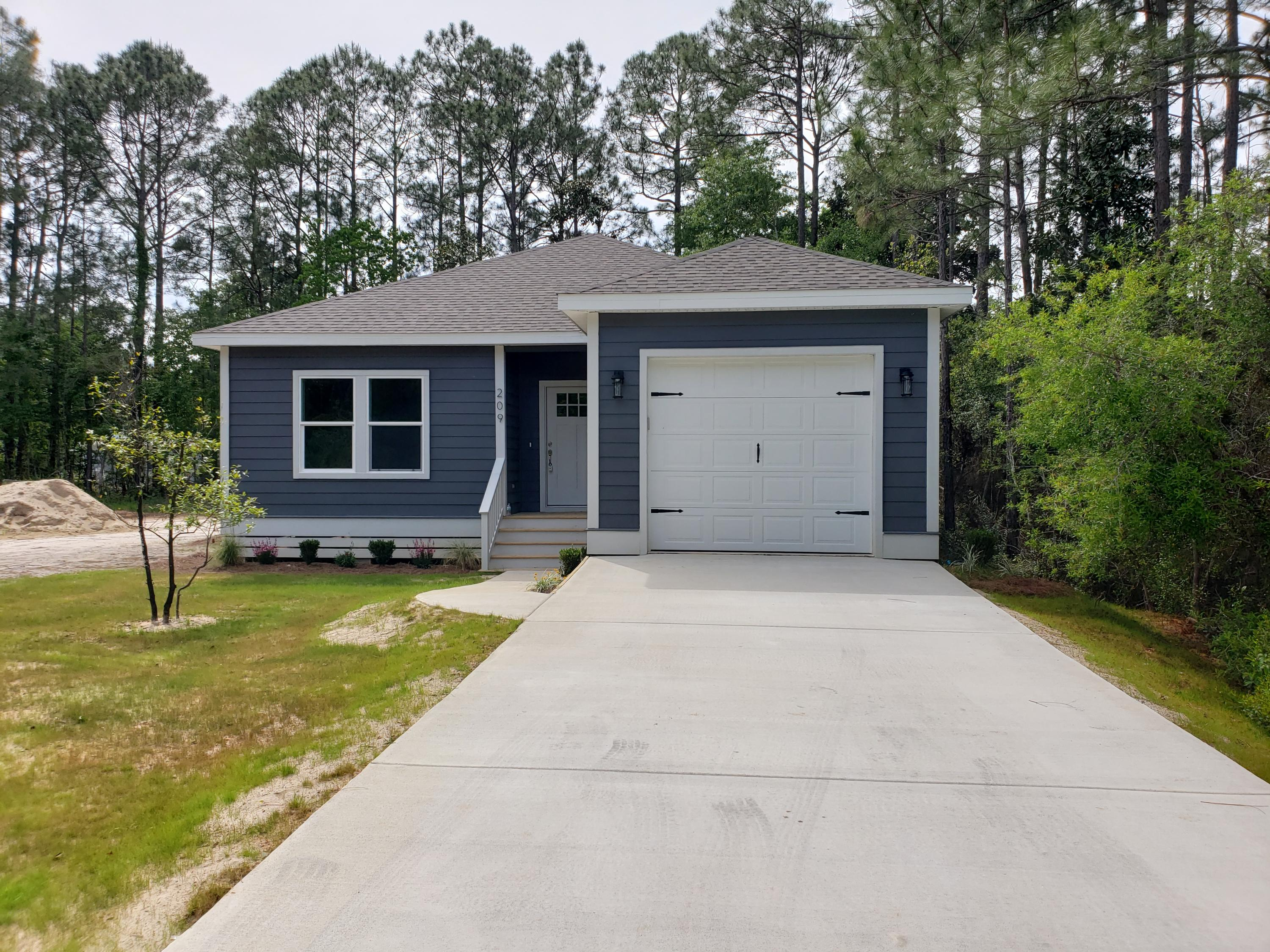NEW CONSTRUCTION in the heart of Santa Rosa Beach! This area is teeming with new development, don't miss your chance to get in on the affordable housing action this neighborhood offers, while enjoying the spoils of a newly constructed home with fine finishes. Beautiful gray toned luxury vinyl plank floors throughout the house. Spacious open concept kitchen/living area. Kitchen with large center island features white shaker cabinets, white quartz counter tops, stainless steel appliances, and large pantry. Enjoy your morning coffee on the covered back deck off the living room. Master bedroom has a large walk in closet, while the master bathroom features double vanity and lots of natural light. 2 guest bedrooms off the foyer share a guest bathroom with unique floating vanity.