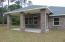 Rear elevation- Coral Isle Floor plan. Large 21'x10' covered lanai.